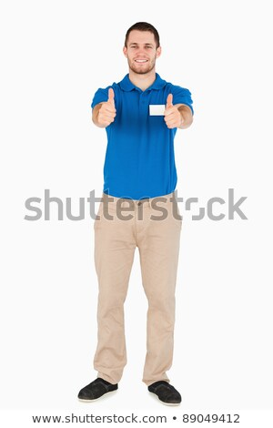 Smiling young sales assistant giving thumbs up against a white background Stock photo © wavebreak_media