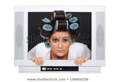 Woman in hair rollers trapped in television Stock photo © photography33