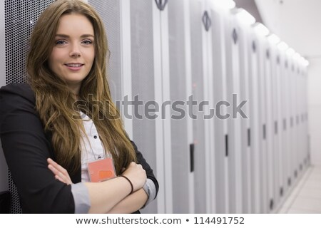 Female worker in data storage facility with folded arms Stock photo © wavebreak_media