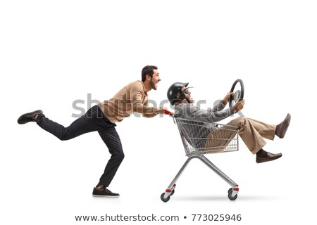Man driving a shopping trolley Stock photo © photography33