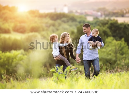 счастливая семья ходьбе парка небе девушки счастливым Сток-фото © serdjo