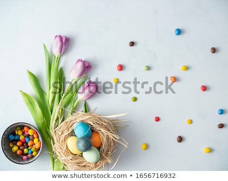 Tulips and candy eggs Stock photo © MKucova