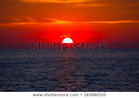 Ibiza San Antonio magic sunset red sky clouds Stock photo © lunamarina