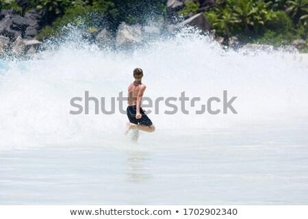 boy enjoying the waves in the wild ocean Stock photo © meinzahn