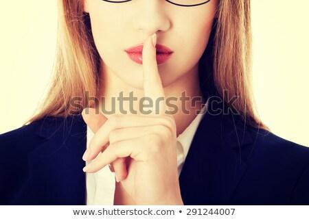beautiful woman making a hushing gesture stock photo © dash