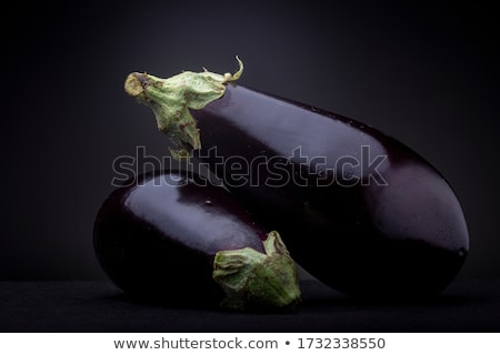 Eggplant or Aubergine on black background Stock photo © stevanovicigor
