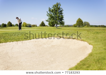 Senior Female Golfer Playing Bunker Shot On Golf Course Stock photo © monkey_business