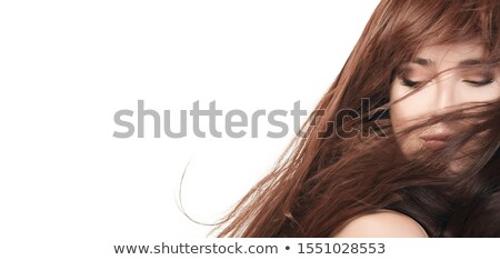 Young beautiful brunette woman with brown eyes and long waving hair  Stock photo © Nejron