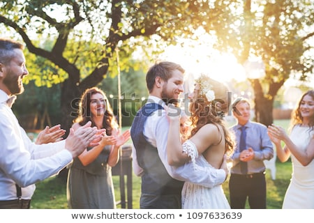 Foto stock: Bride And Groom Celebrating With Guests At Reception