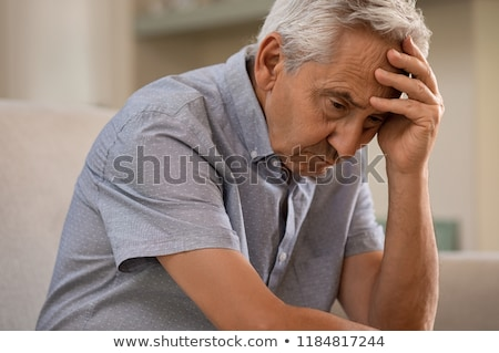 mature man with depressed look stock photo © tab62