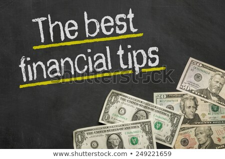 Text on blackboard with money - The best financial tips Stock photo © Zerbor