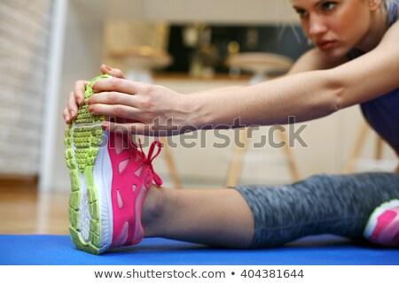 Femminile abbigliamento sportivo rilassante allenamento Foto d'archivio © HASLOO