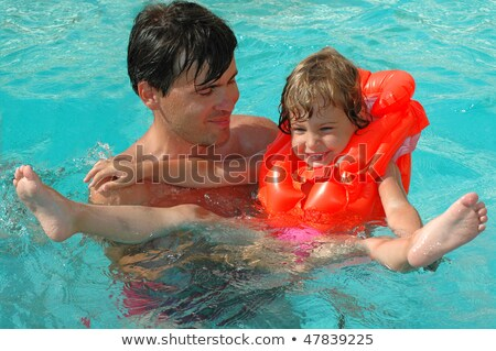little girl in inflatable waistcoat in pool Stock photo © Paha_L