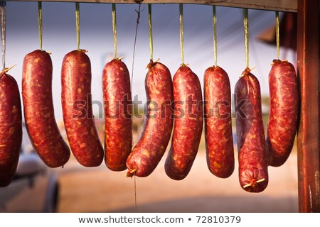 smoked sausage and bacon in a street market stock photo © smuki