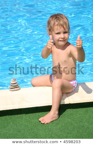 The girl has constructed a figure of stones about pool Stock photo © Paha_L