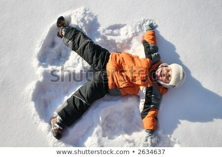 enfant · mensonges · neige · colline · visage · hiver - photo stock © Paha_L