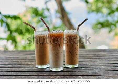 üveg jeges kávé fa asztal stock fotó Stock fotó © punsayaporn
