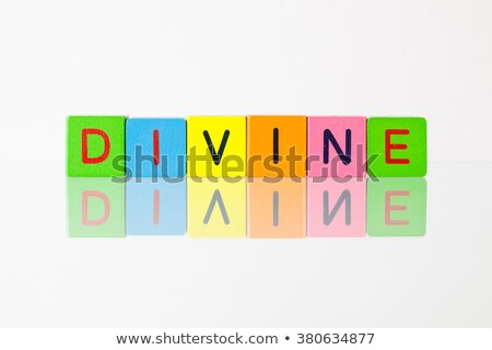 Divine - an inscription from children's blocks Stock photo © CaptureLight