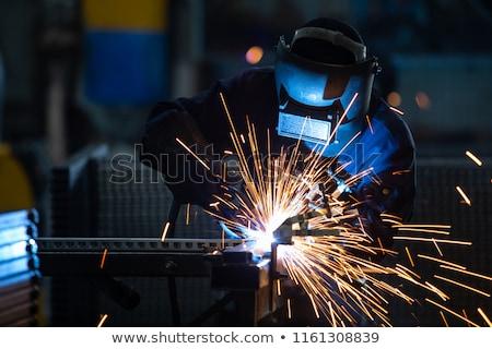 welder with protective mask welding metal and sparks stock photo © zurijeta