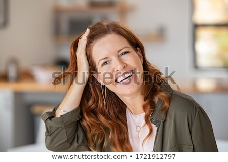 red haired woman looking confident and happy Stock photo © meinzahn