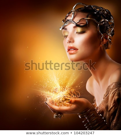 Stock photo: Beautiful young beauty in a golden ring