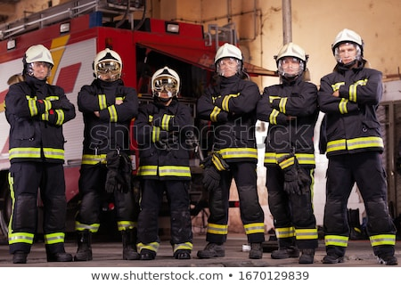 A group of firemen Stock photo © bluering