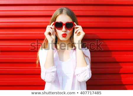 Lovely woman with red lipstick Stock photo © racoolstudio