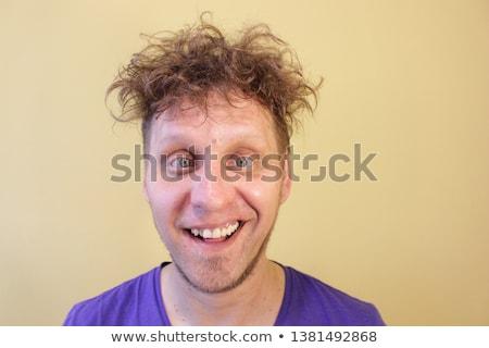 Hülye arc fiatal üzletember készít stúdiófelvétel Stock fotó © filipw