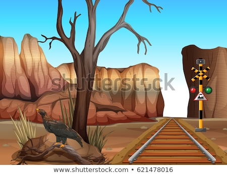Train on the track to the western town Stock photo © bluering