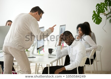 African-american furious businessman screaming. Stock photo © RAStudio