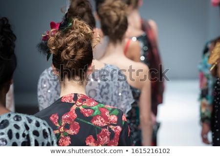 woman posing on catwalk during fashion show stock photo © rastudio
