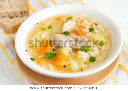 Chicken soup with noodles and vegetables in white bowl Stock photo © Yatsenko