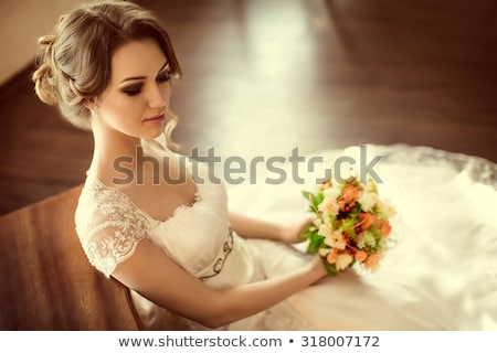 young woman in dress holding hand on head posing  Stock photo © feedough