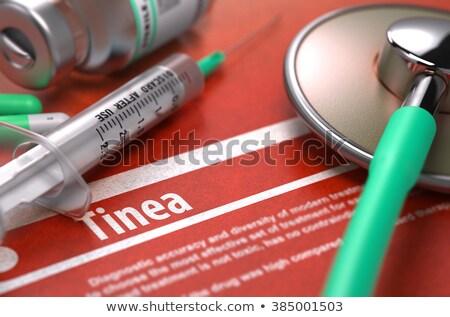 Tinea - Printed Diagnosis on Orange Background. Stock photo © tashatuvango