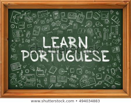 hand drawn learn portuguese on green chalkboard stock photo © tashatuvango