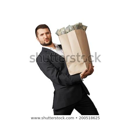 Kaukázusi üzletember tart pénz táska üzletember Stock fotó © RAStudio