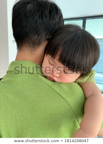 Stock photo: Girl putting head on fathers shoulder
