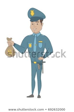 Young hispanic policeman holding a money bag. Stock photo © RAStudio