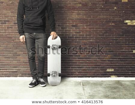 Young skateboarder man holding skateboard Stock photo © deandrobot