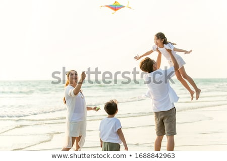 Woman & boy on beach with kite stock photo © IS2
