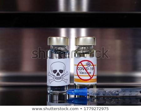 Crânio seringa médico isolado preto azul Foto stock © Klinker