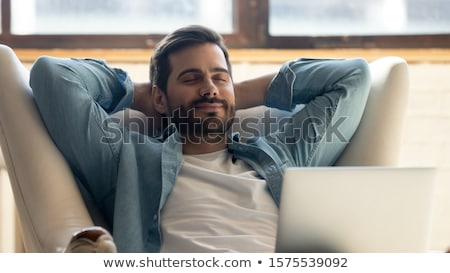 businessman hands on head, eyes closed Stock photo © IS2
