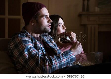 Oldalnézet koncentrált pár néz film otthon Stock fotó © LightFieldStudios