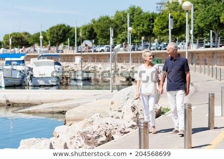 Middle aged couple on an old boat Stock photo © IS2