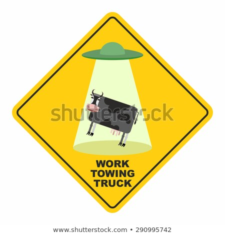 Road sign: works breakdown truck. UFO picks up a cow. Hilarious  Stock photo © popaukropa