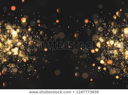 particle golden glitter celebration background stock photo © SArts