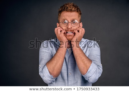 Nervous man bites fingernails Stock photo © stevanovicigor