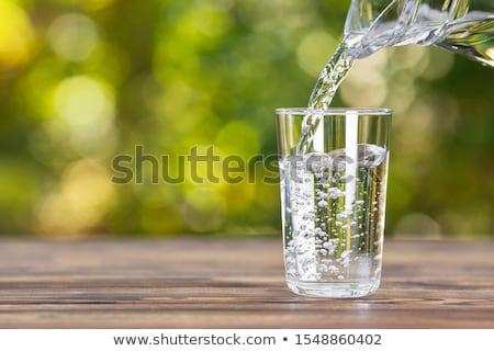 Szkła wody drewniany stół odizolowany biały drewna Zdjęcia stock © Cipariss