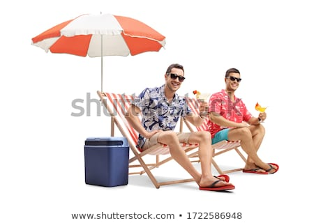Two deck chairs and an umbrella on the beach Stock photo © tracer