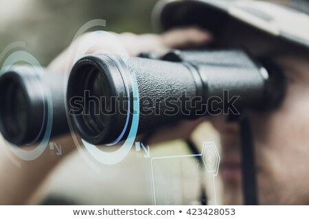 close up of soldier face looking to binocular Stock photo © dolgachov